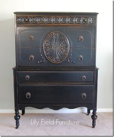 antique high boy with glossy black finish
