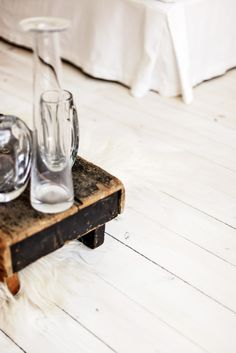 Wooden box + glass vases. White floor
