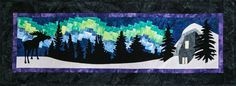 Borealis Ridge is the 2nd quilt in a series of scenic row quilts designed by Marie Noah