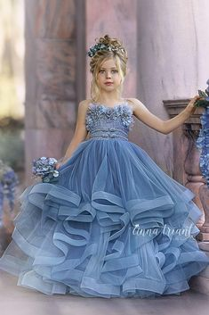 Step into the luxurious world of little girls gowns by Anna Triant Couture and experience the magic of innovative style in every perfect stitch. Flower Girl Outfits, Princess Flower Girl Dresses, Girls Blue Dress, Princess Dress Kids, Princess Girl, Dress Girl, Little Girl Gowns, Gowns For Girls, Frocks For Girls