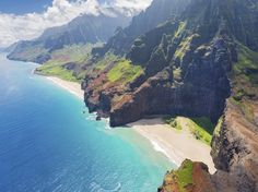 """Rain falls on Mount Wai'ale'ale almost 360 days a year, but the weather on the rest of Kauai isn't nearly so bad. And from rainforests to massive canyons to hidden beaches, it's the site of incredible biodiversity—one look at the Nā Pali Coast or Waimea Canyon (also known as """"the Grand Canyon of the Pacific"""") is a crash course in love at first sight. —D.J., C.M."""