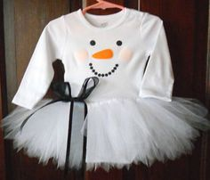 Sheer black ribbon to accent this little snow girl's darling face.  Sweet tutu too.