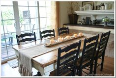 love this farmhouse table with burlap runner and skinny tray with candles and seashells - more photos on blog