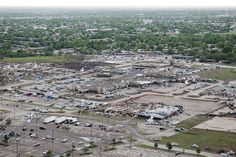 After the devastating tornadic activity in Moore, Okla., a military and law enforcement presence helps to curb loitering and maintains security in the area May 21, 2013. This established housing addition is now a wasteland after a massive tornado hit the area May 20 leaving leveled houses, businesses and schools in its wake. (U.S. Air Guard photo by Tech. Sgt. Roberta A. Thompson)(RELEASED)