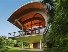 Incredible curved gluelam timber members support the organic design and volume of this home.