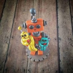 Happy robot dad with lil bot children that went off to Hawaii on this day a few years ago | Handmade by HerArtSheLoves of Robots Are Awesome http://theawesomerobots.com