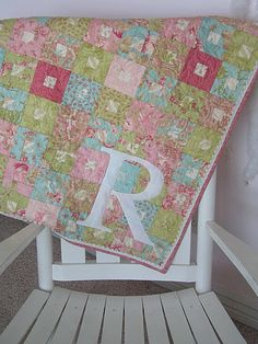 square-in-square with appliqué  monogram... quilt ideas for @Marnie Ebensperger