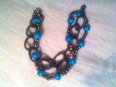 Bracelet to match blue and black choker.