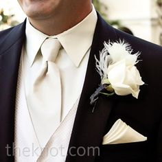 White Rose and Feather Boutonniere