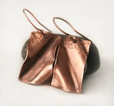 Metalwork copper earrings feature folds, hammered texture accents with waves and ripples to delight the senses. Unique, lightweight and one of my