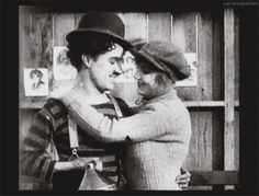 """Charlie Chaplin & Edna Purviance share what would be their first onscreen kiss in his film """"THE CHAMPION"""" - 1915  Essanay Film"""