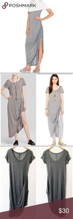 Free People Harvest Moon Drape-Hem T-Shirt Dress One small tiny hole in the back as shown in picture but otherwise in excellent condition with no other flaws. Free People harvest moon asymmetrical Maxi dress in gray.  Product Details: Polyester/rayon blend, Hand wash, Imported, Scoop neckline, Pullover, Short sleeves, Draped hem with slit on side, Jersey knit, Maxi silhouette. Free People Dresses Maxi