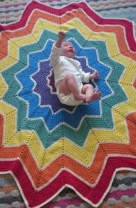 Peggy on her rainbow ripple baby blanket, crocheted by yours truly :-) © Leonie Hinchliff
