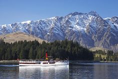 TSS Earnslaw sailing on Lake Wakatipu, with The Remarkables in background.