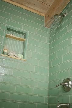 Green subway tile in shower stall
