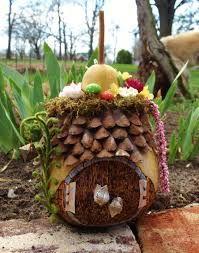 Resultat d'imatges de fairy houses that have plants growing on them