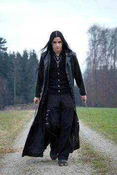 Sexy goth male!   Long black vamp-style coat.  Definitely need to comeback!
