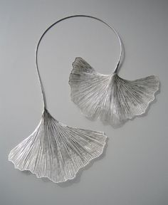 "Necklace | Maria Jauhiainen. ""Gingko"".  Sterling silver. With silk cord"
