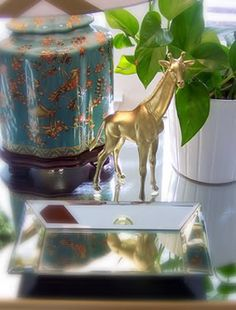 Spray paint plastic kid toy animals- love the metallic paint,,, by Little Green Notebook