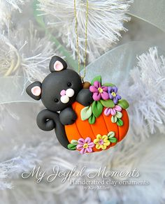 Handcrafted Polymer Clay Halloween Cat with by MyJoyfulMoments (same idea but with a Christmas ornament instead of pumpkin)