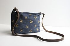 A great compact every day bag and the perfect size for your essentials with an adjustable cross-body leather strap.  Hand screen printed with