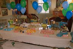 balloons in the clue colors, appetizer table, detective items. cadettes special agent badge