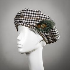 d772d67e Fabulously stylish beret in three striking Scottish tweeds, trimmed with a  removable feather pin. Black, White and Brown check, One Size.