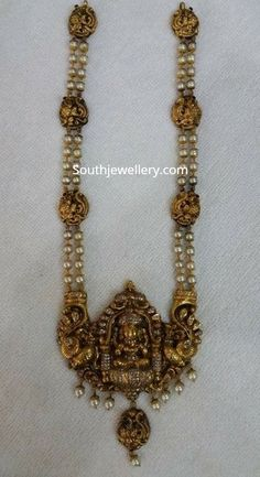 Jewelry OFF! Two line south sea pearl mala with Goddess Lakshmi pendant studded with diamonds. Pearl Necklace Designs, Jewelry Design Earrings, Gold Jewellery Design, Gold Necklace, Pearl Necklaces, Vintage Jewellery, Indian Wedding Jewelry, Indian Jewelry, Bridal Jewelry