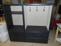 Entryway or Mudroom organizer. Another use for those old entertainment centers. Saw this piece on Craigslist. This unique mudroom piece has been reborn from a no longer used entertainment center!
