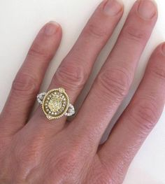 Love as a right hand ring. Super unique. Natural Unheated Yellow Sapphire and Diamond Ring in 14k white and yellow gold