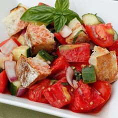 Panzanella  Panzanella is a Tuscan bread salad which combines day old bread, tomatoes, basil, cucumbers, red onion and olive oil. A perfect summer dish for lunch or as a side.