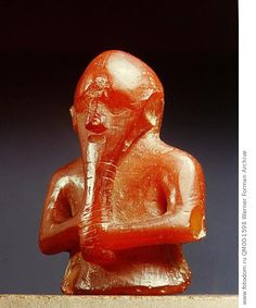 Figurine, probably a chessman which may represent Thor. Country of Origin: Denmark. Culture: Viking. Date/Period: Viking Age. Place of Origin: Feddet, East Zealand. Material Size: amber. Credit Line: Werner Forman Archive/ National Museum, Copenhagen . Location: 13.