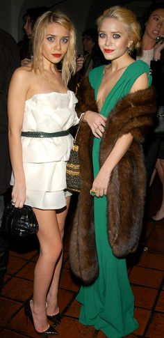 OLSENS ANONYMOUS MKA MARY KATE ASHLEY OLSEN FASHION STYLE BLOG WHITE STRAPLESS SATIN SHORT RUFFLE DRESS GREEN PYTHON SNAKE BELT CROC CLUTCH CROC LOUBOUTIN HEELS PUMPS RED LIPSTICK FUR STOLE LOW CUT GREEN DRESS EMERALD RING METALLIC WOVEN BUCKET BAG