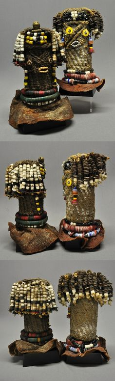 Africa   Dolls from northern Namibia or southern Angola   Wood covered in woven plant fiber.  Numerous brass and bead ornaments