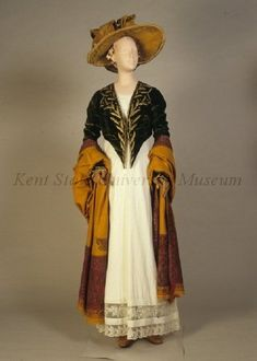 Kent State  Collection C. 1810, Spencer jacket of emerald green velvet embroidered with green silk and gold thread.