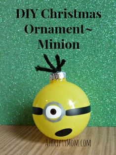 Use nail polish for the face. Cute diy christmas Minion ornament! Children would love it as a gift too.