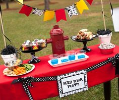 """10. Puppy Party Decorations – the Doghouse If you're already having this party at a park, decorating isn't an area you need to go crazy in. To keep it minimal: Pick one """"WOW"""" piece. For us, this was the DIY doghouse. I picked it up for about $12 with a coupon at the craft store …"""
