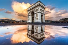 Arc de Triomphe puddle mirror with a cloudy sky by Loïc Lagarde on 500px