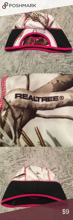 ❗️LAST CHANCE GOING TO GOODWILL❗️Realtree Hat Never before worn Realtree pink and white beanie type hat. Hot pink trim around edges and hot pink stitching throughout. Snow White camouflage coloring on body of hat. Brand New! Smoke free home! Realtree Accessories Hats