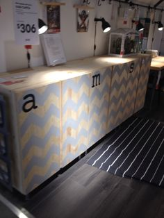 IKEA Ivar painted with silver chevron. Saw this at my local ikea and I love it!  I wish It came already painted! Great idea for hidden storage in playroom!