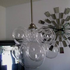Bubble chandelier!! Bubbles from CB2... Fishing wire to hang them!