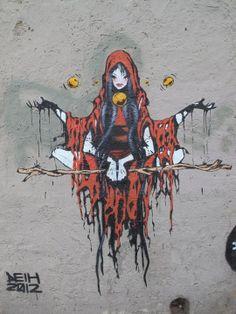 She looks like a spooky little red riding hood.