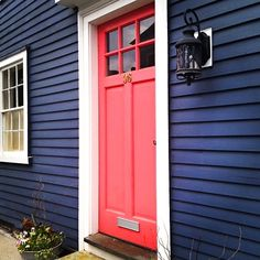 Midnight blue clapboard house, light red door, white door and window trim, black lantern - beautiful color combination @ http://lightingworldbay.com #lighting