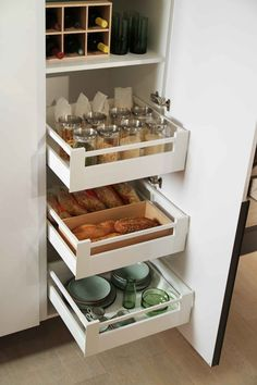 The Snaidero Passepartout storage solution line can help your kitchen clean and organized. The shelves and pull-out drawers are made to help you fit all loose items inside one cabinet.  #SnaideroUSA
