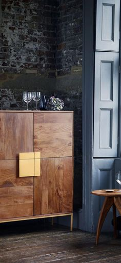 The Banner cabinet in mango wood with antique brass handles. A bold design that is right on trend for 2018.