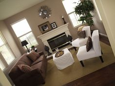 tnabee: Living Room decor project in the works  Chocolate brown sofa, white, slipcovered chairs ...
