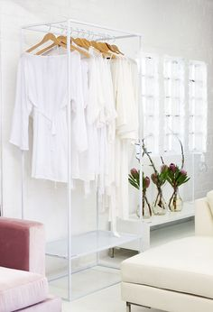 Sleek epoxy clothing rack with shelf... display your clothes in style