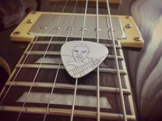 This awesome silver pick is inspired by Robert Johnson (1911-1938), The Legend  Made of rhodium plated sterling silver 925  Dimensions: 30mm height, 0.6mm thickness  Our designs of the silver picks are based on famous pictures related to music history  Manufacturing process includes treatment by hand and laser engraving.