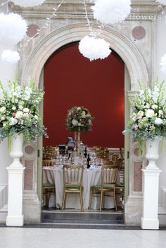 Entrance to Hampton Court House Dining Room decorated with striking flowers in urns Wotton House, Hampton Court House, Topiary Centerpieces, Tall Flowers, Wedding Entrance, Wedding Inspiration, Wedding Ideas, Rustic Wedding Flowers, Courthouse Wedding