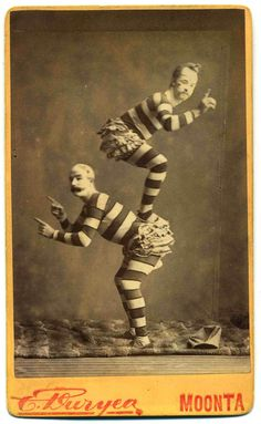 "These two are acrobats or clowns photographed in Moonta South Australia, circa 1880.  Mark St Leon, author of Circus, The Australian Story believes these two fellows could be William Hayes and Harry Benham (real name Gilmore, sometimes known as ""Merry Benhamo""), who came to Australia from London about 1878 to join Burton's Circus. The pair soon broke their contract and went off on their own as the English Circus and visited South Australia in 1880-81 before proceeding to Western Australia."